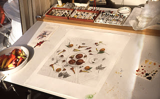hand coloring table in 1990 with an image in progress